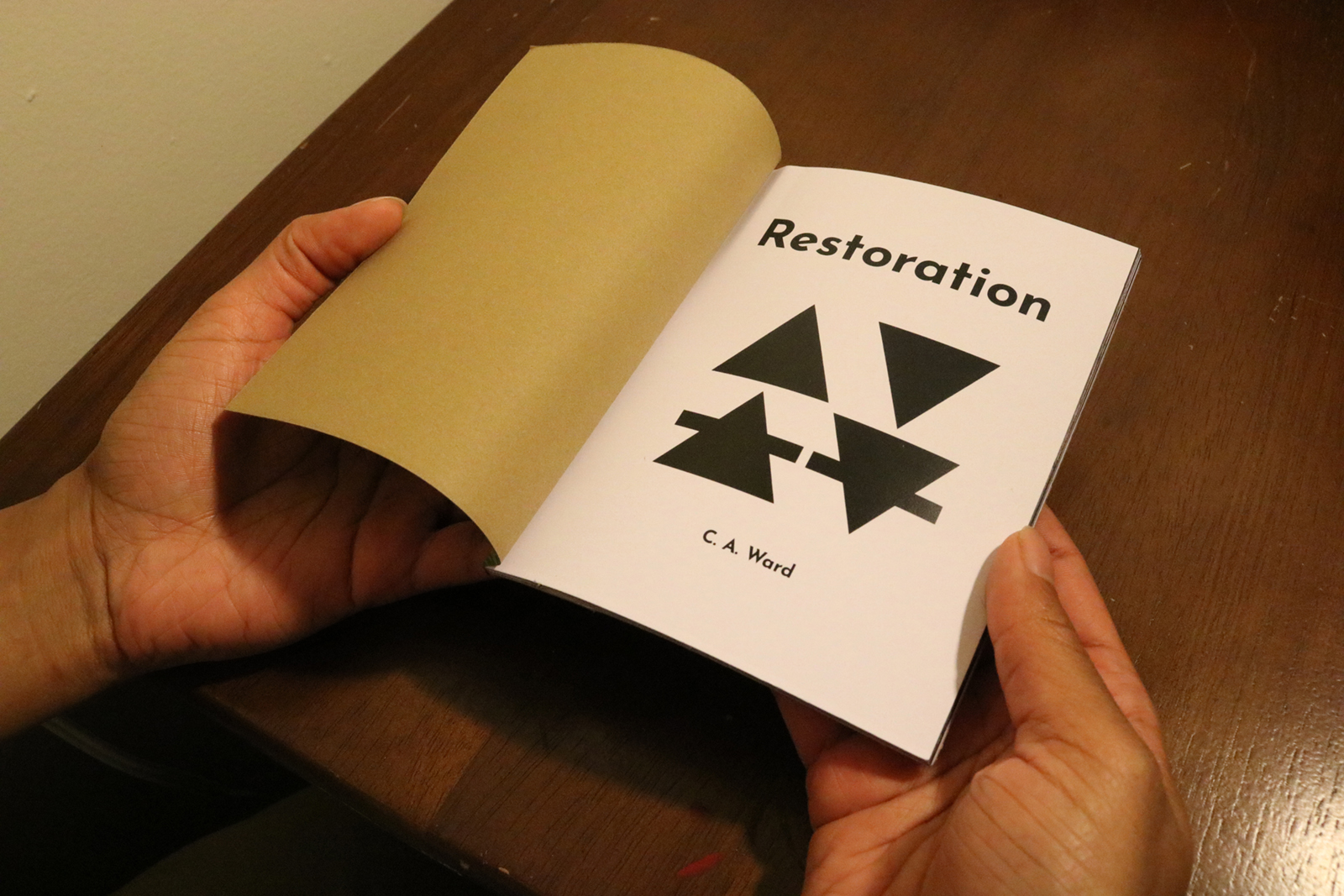 Title page of Restoration. The images are of the elemental symbols.